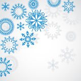 Snowflakes. The blue snowflakes on the white background Stock Photography