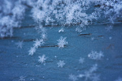 Snowflakes on Blue Wood Stock Image