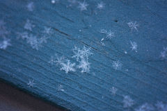 Snowflakes on Blue Wood Stock Photos