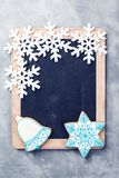Snowflakes border on chalkboard. Christmas background with copy space. New Year and Christmas. Chalkboard mock up with snowflakes. And gingerbread. Winter royalty free stock photos