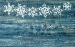 Snowflakes border over rustic wooden background. winter holidays stock photography