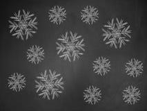 Snowflakes on chalkboard Stock Photos