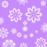 Snowflakes. Christmas seamless pattern from big and small white snowflakes on blue background Stock Images