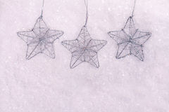 Snowflakes christmas tree decoration on white snow background.  New, year, winter holidays, abstract seasonal background Royalty Free Stock Images