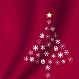 Snowflakes Christmas Tree Red. Snowflakes form a Christmas tree, with a star on top, on a red velvet background Royalty Free Stock Images