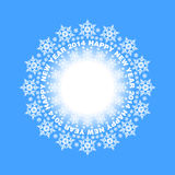 Snowflakes in a circle on blue background Royalty Free Stock Images