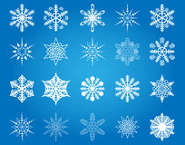 Snowflakes collection. Collection of 20 snowflakes on a blue background Vector Illustration
