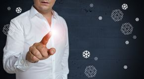 Snowflakes concept touchscreen is operated by man Stock Image