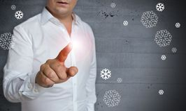 Snowflakes concept touchscreen is operated by man Royalty Free Stock Image