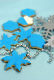Snowflakes cookies. For Christmas with blue royal frosting and sparkling decorations Stock Photo