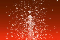 Snowflakes creating Christmas tree. Falling snowflakes creating a white Christmas tree with a star on the top.  Orange gradient background stock footage