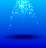 Snowflakes crystal under light blue background. Snowflakes crystal under light on blue background Royalty Free Stock Photo