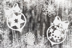 Snowflakes cut out of paper on dark background with space for text Christmas theme Royalty Free Stock Image