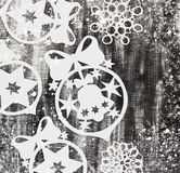 Snowflakes cut out of paper on dark background with space for text Christmas theme Royalty Free Stock Photography
