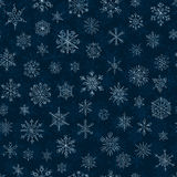 Snowflakes on a dark blue background Royalty Free Stock Photography