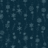 Snowflakes on a dark blue background Royalty Free Stock Images