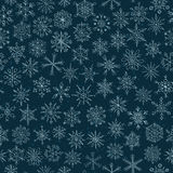 Snowflakes on a dark blue background Royalty Free Stock Image