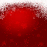 Snowflakes on a dark red background. Dancing snowflakes on a dark red background Stock Photo