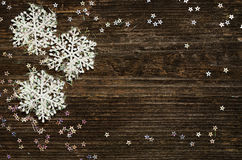 Snowflakes on dark wood Royalty Free Stock Image