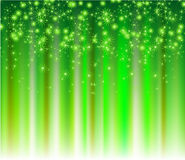 Snowflakes descending on a path of green light Stock Photo