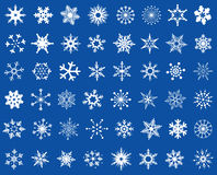 Snowflakes design set. Abstract snowflakes design set mixed, white on blue background Stock Photography