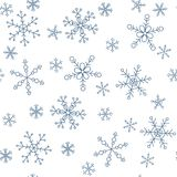 Snowflakes of different styles on a background of blue, pattern. The background pattern for winter themes. Snowflakes five styles, two groups of sizes. Color Royalty Free Stock Photo
