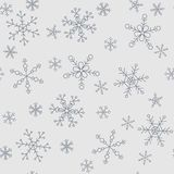 Snowflakes of different styles on a background of gray, pattern. The background pattern for winter themes. Snowflakes five styles, two groups of sizes. Color Royalty Free Stock Photo