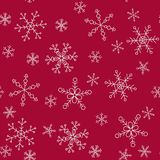 Snowflakes of different styles on a background of red, pattern. The background pattern for winter themes. Snowflakes five styles, two groups of sizes. Color red Stock Photos