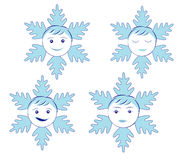 Snowflakes with faces. A set of snowflakes decorated with faces Royalty Free Stock Photography