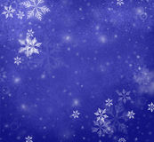 Snowflakes falling on blue Christmas background, winter background Stock Image