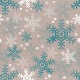Snowflakes falling down in a cluster. White and blue transparent snow theme on beige cardboard paper seamless texture Stock Image