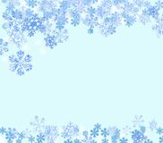 Snowflakes falling, light blue background royalty free stock photo