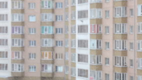 Snowflakes falling, winter window view. Apartment building. Blurred background stock video