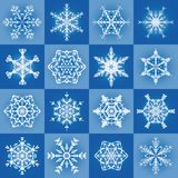 Snowflakes Filigree Pattern Background. Snowflakes - filigree blue christmas pattern background with sixteen different tiles - seamless extendable vector Royalty Free Stock Photography