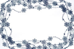Snowflakes frame. Christmas frame made of silver snowflakes garland on white Royalty Free Stock Photos
