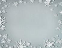 Snowflakes frame on cold gray background with copy space, top view. Christmas and winter holiday concept royalty free illustration