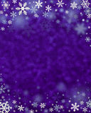 Snowflakes frame on defocused background Stock Images