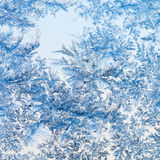 Snowflakes and frost pattern on glass close up Stock Images