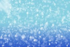 Snowflakes and glare. Background with snowflakes and glare of light on a blue background for winter and new year Stock Image