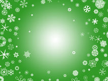 Snowflakes - green. White snowflakes on a green background Stock Photos