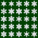 25 snowflakes on green background. 25 white different snowflakes on green background - good image for a christmas, new year and winter themes Stock Images
