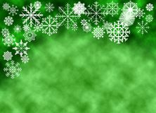 Snowflakes on green bokeh background stock images