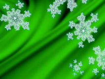 Snowflakes on green velvet background Royalty Free Stock Image