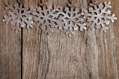 Snowflakes on grunge wood Royalty Free Stock Photo