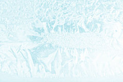 Snowflakes and ice on frozen window Stock Images