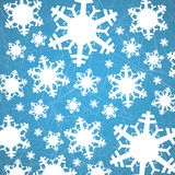 Snowflakes on ice with furrows - Christmas background Royalty Free Stock Image