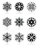 Snowflakes icon set on black and white background Stock Images