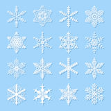 Snowflakes icons. Sixteen snowflake icons. White on the blue Stock Illustration