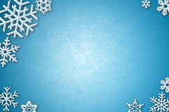 Snowflakes on icy background. Snowflakes on blue background with skating ice texture Royalty Free Stock Photo