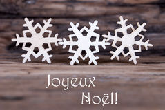 Snowflakes with Joyeux Noel Royalty Free Stock Photos
